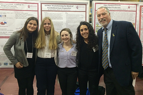 Stevens students at a research poster session with Dr. Don Lombardi.