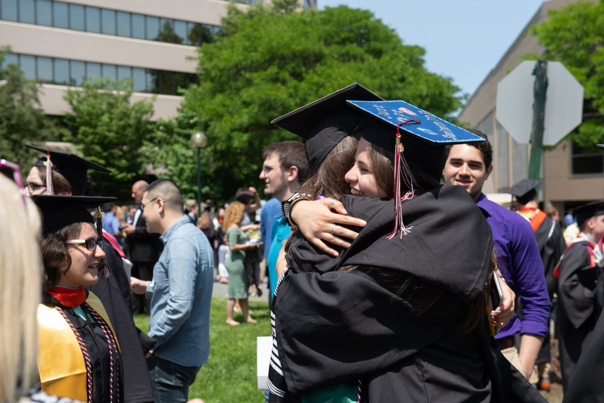 Class of 2019 graduates hugging outside the Meadowlands Expo Center