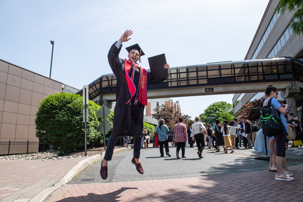 Class of 2019 graduate jumping for joy outside the Meadowlands Expo Center