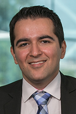 Headshot of Dr. Amir Gandomi with the New York City skyine in the background.