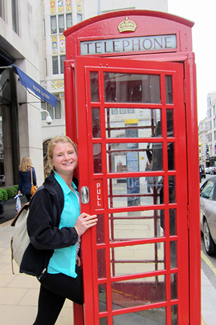 A student outside a phone booth in London.