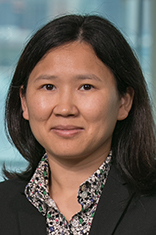 Headshot of Dr. Emily Liu with the New York City skyline in the background.