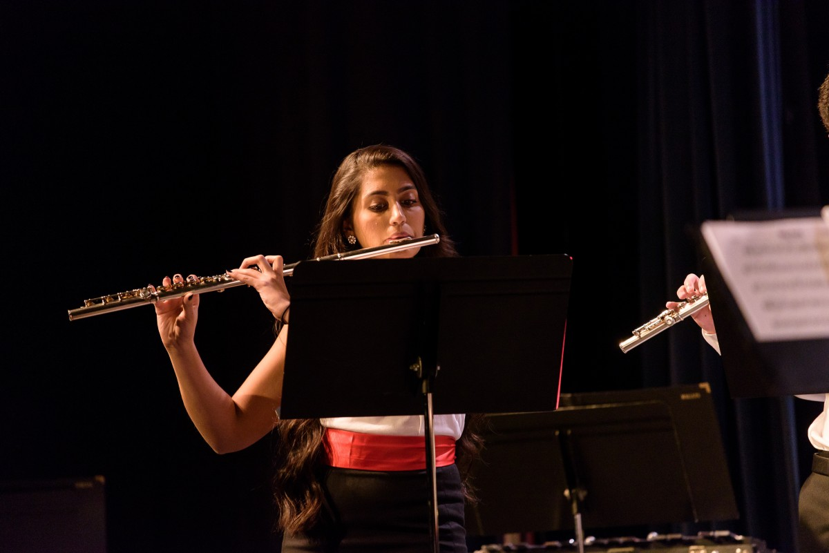 Moenika Chowdhury playing the flute