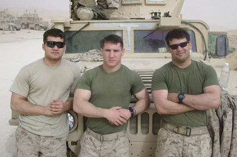 Ryan Bridge and two other servicemen in front of a Humvee in Iraq.