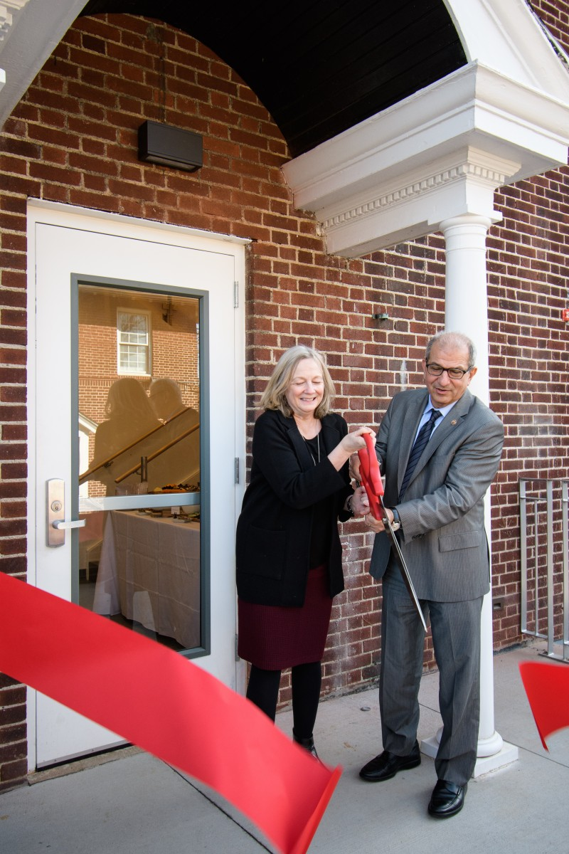 From left to right: Marybeth Murphy, vice president for enrollment management and student affairs, and Stevens President Nariman Farvardin cutting a red ribbon outside the entrance of the Student Wellness Center