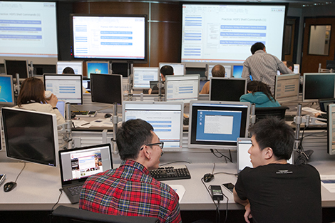 Students learn Hadoop at a software boot camp in Stevens' Hanlon Lab.