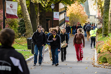 Stevens students walk to class together as a group. The university maintains a small student-faculty ratio for effective learning and collaborative work.