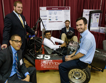 A group of students with their senior design project