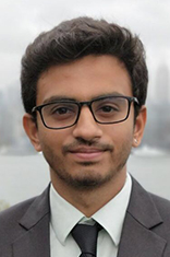 Headshot of Jeet Kothari with New York City visible in the background.