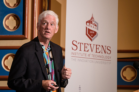 Peter Norvig, of Google, at the podium as he presents a lecture at Stevens.