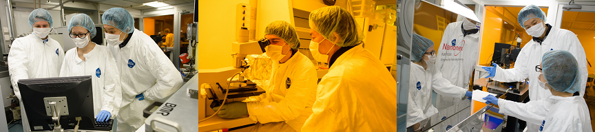 students in clean suits looking into microscopes in the lab