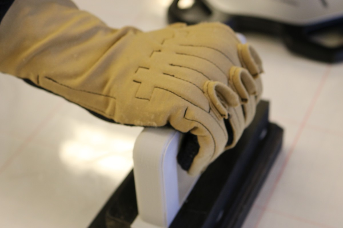 Patel demonstrates a grip test with her glove.