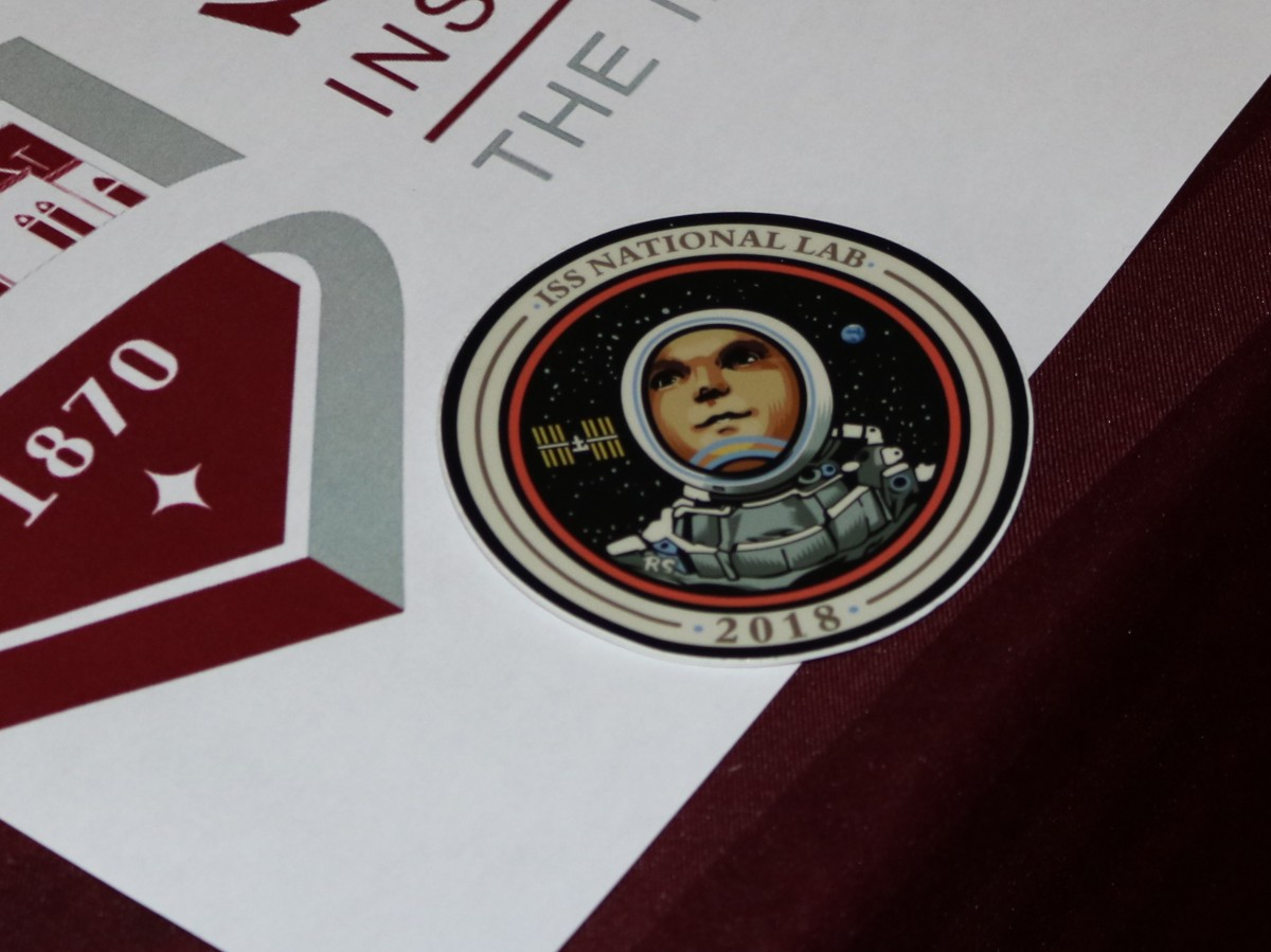 CAPTION: The 2018 ISS patch on top of the Stevens logo. CREDIT: Stevens.