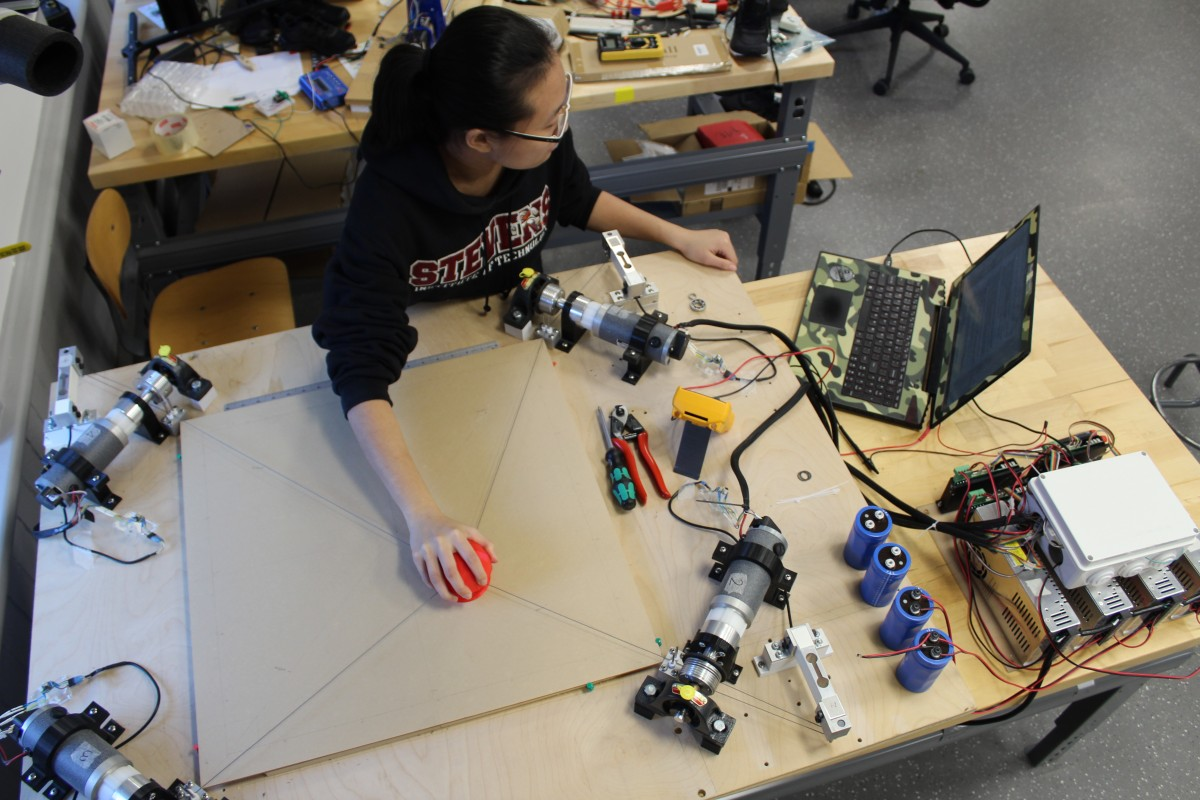 Qianwen Zhao, using her robot-assisted Haptic Joystick therapeutic device in the Wearable Robotic Systems Laboratory.