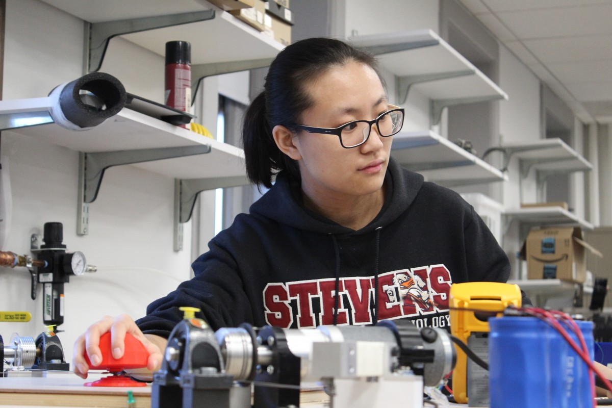 Qianwen Zhao, using her robot-assisted Haptic Joystick therapeutic device in the Wearable Robotic Systems Lab