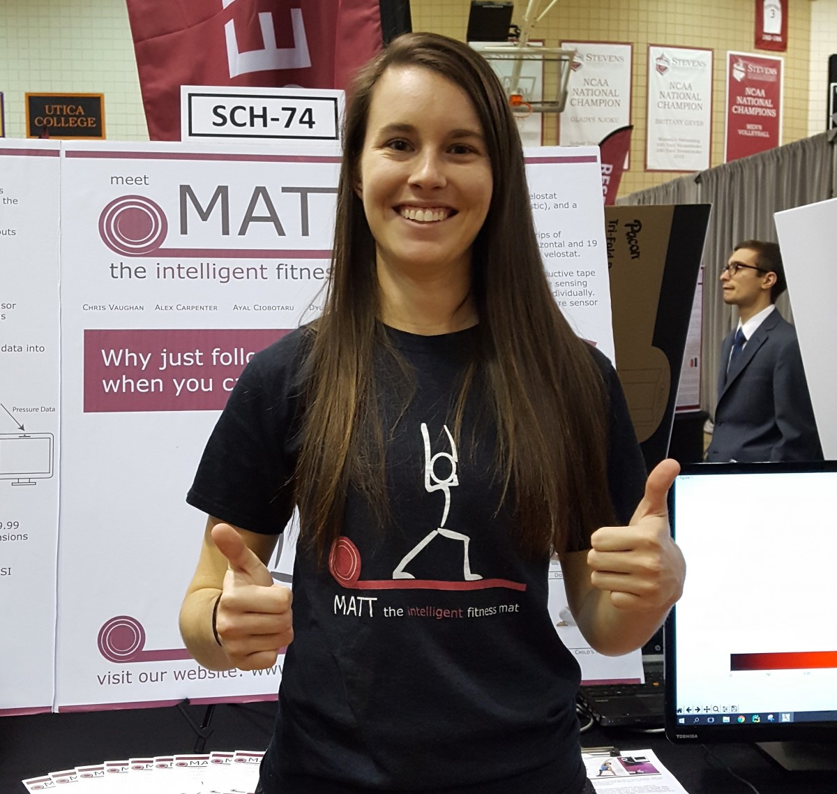 Sara Vitkus, 2017 Class Valedictorian, giving a thumbs-up at Stevens Annual Innovation Expo