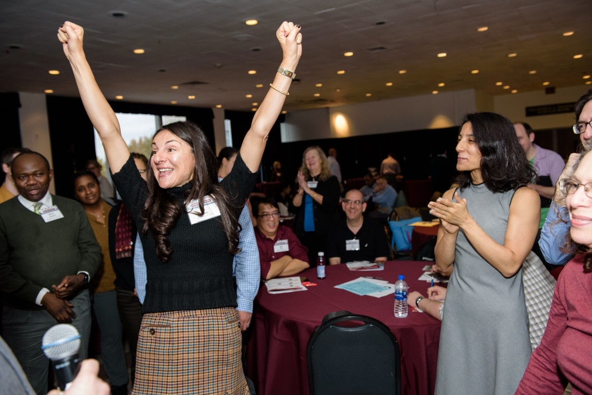 The winner of the rock—paper—scissors tournament celebrates with her fellow participants. CREDIT: Jeff Vock