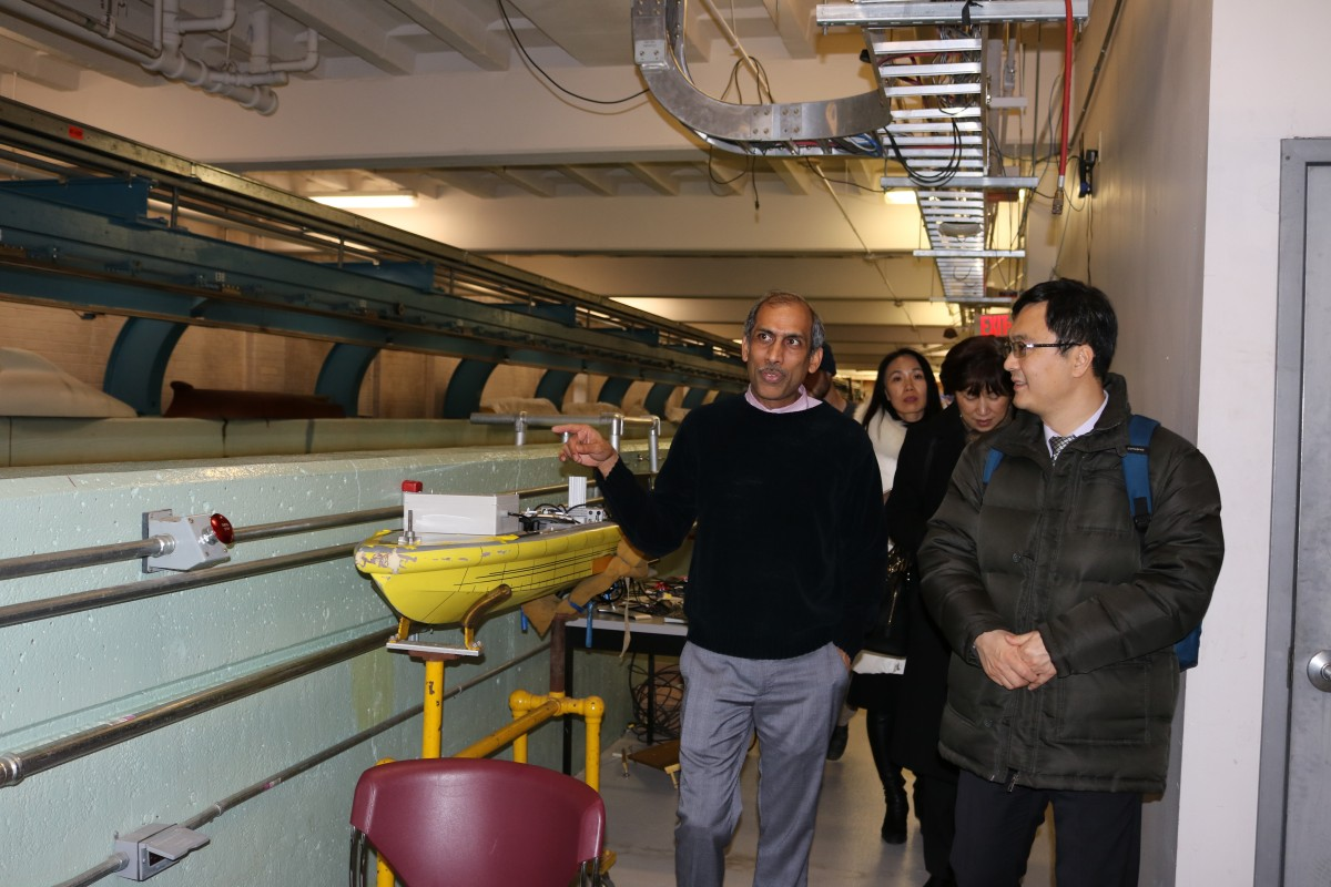 Raju Datla leads Zhang and Song on a tour of the Davidson Lab.