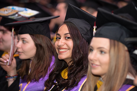 Sheila De Assis in her cap and gown at commencement.