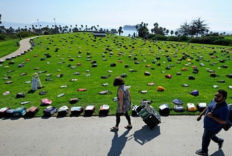Backpacks on green campus lawn
