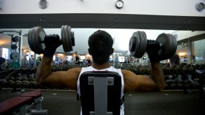 Male student lifting weights