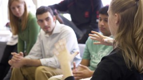 Students discussing something in a classroom