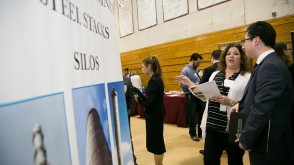 Recruiters and students speaking at a career fair
