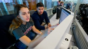 A pair of students examine Bloomberg data in the Hanlon Financial Systems Lab.