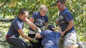 EMBA students put their learning to test by overcoming physical obstacles during a weekend leadership retreat.