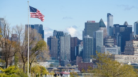 American flag flying on campus with Manhattan in background