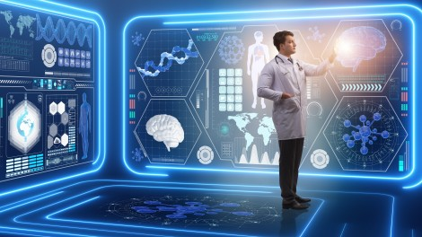 Man in lab coat and stethoscope staring at screens of biomedical info