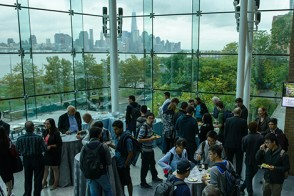 Students and faculty network with industry professionals before a Heath Lecture Series event begins.