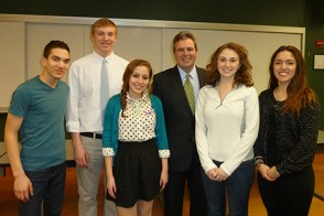 Rich Pettricione poses for a photo with Stevens students following his address on leveraging events to make impact.