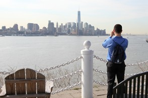 A students wanders off from the campus tour to take a quick photo of the New York City skyline from the Stevens campus.