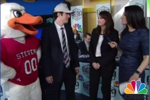 Axilla the duck with two students being interviewed by a reporter.