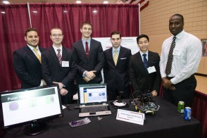 A student team exhibits its project