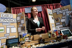 A female student showcases some of her products at the expo.