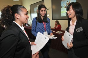 Dr. Ying Wu, right, answers questions of high school students during Trading Day.