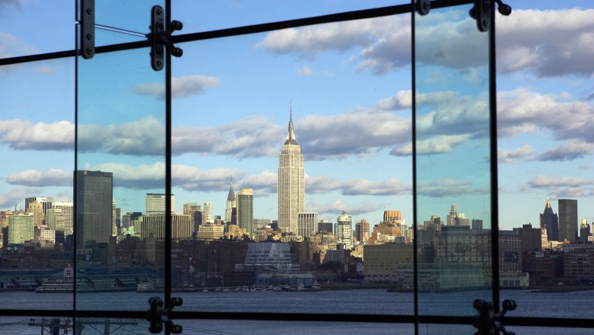A view of lower Manhattan's skyline from Babbio's atrium. The shot is taken from inside the atrium, which consists of floor to ceiling windows.