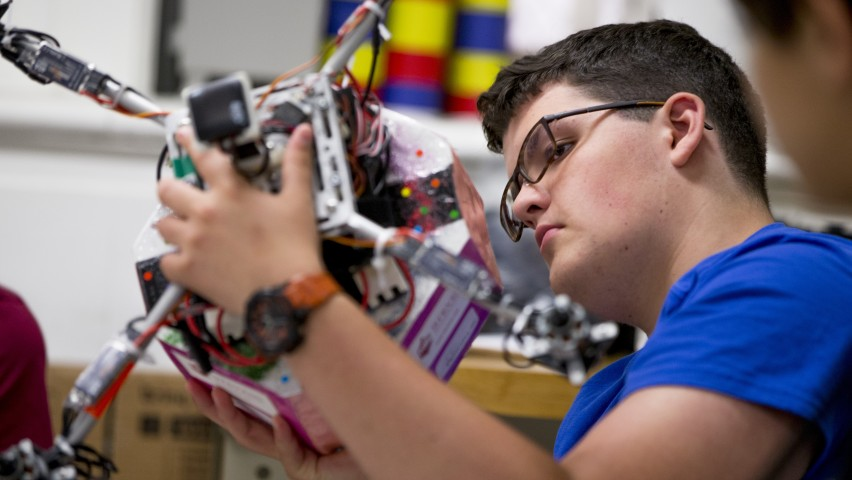 Pre-College student works with electronics
