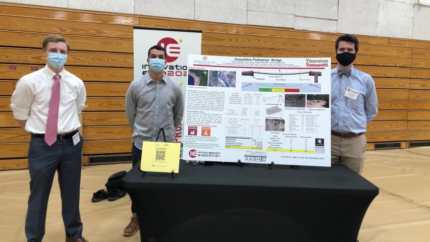 students with poster at Innovation Expo