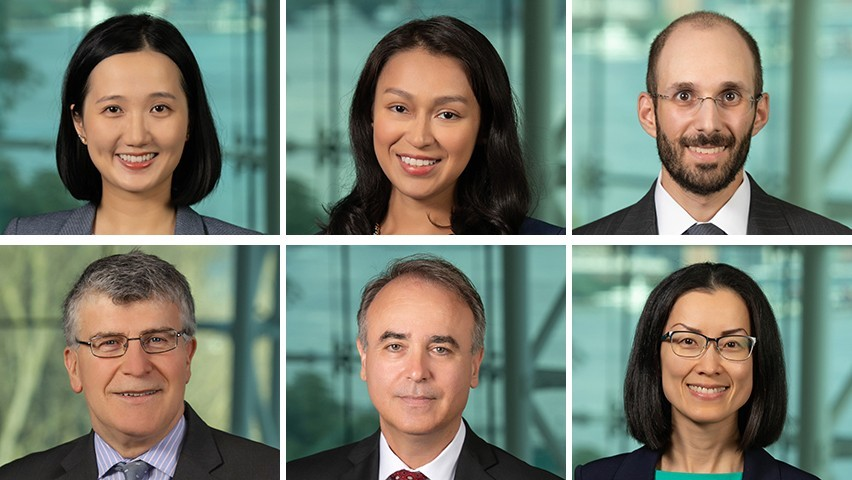 Headshots of the Stevens business faculty who started in fall 2019. New York City is in the background.