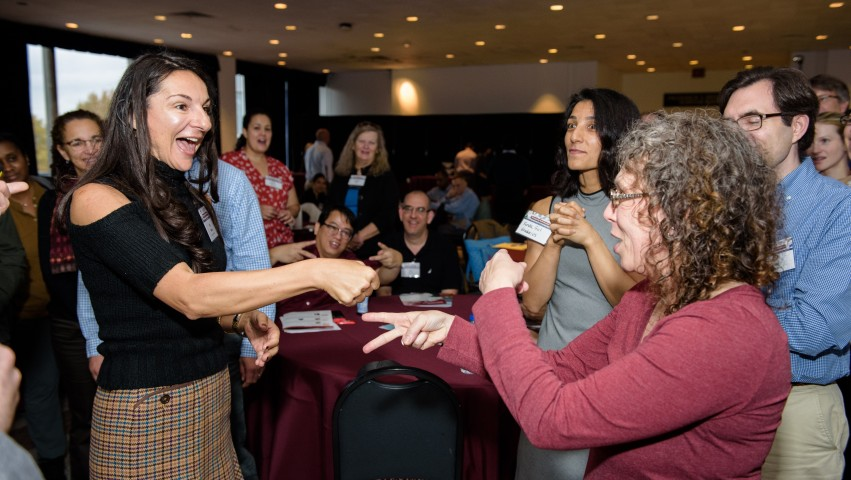 CAPTION: participants engage in a rock—paper—scissors tournament at the Reimagining Math Education conference. CREDIT: Jeff Vock