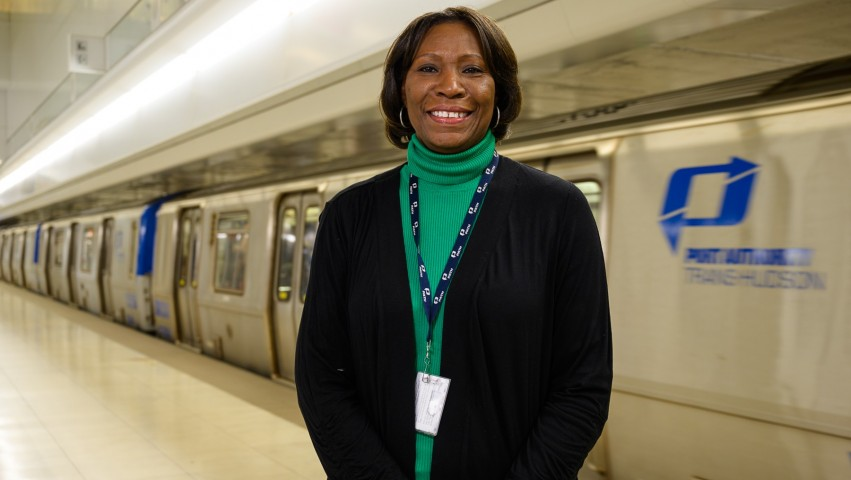 Clarelle DeGraffe standing next to a PATH train