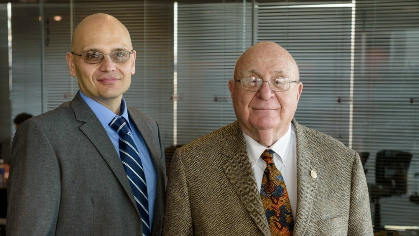 New Computer Science faculty chair Giuseppe Ateniese (pictured left) and Stevens alumnus David Farber