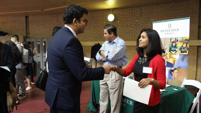 Male Stevens student shakes hands with recruiter from Bessemer Trus