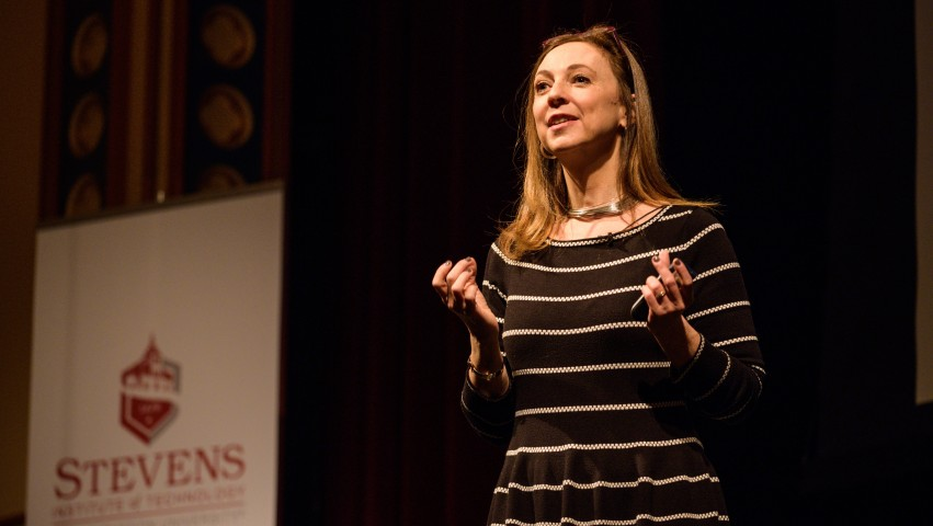 Susan Cain on stage facing an audience in DeBaun Auditorium at Stevens Institute of Technology