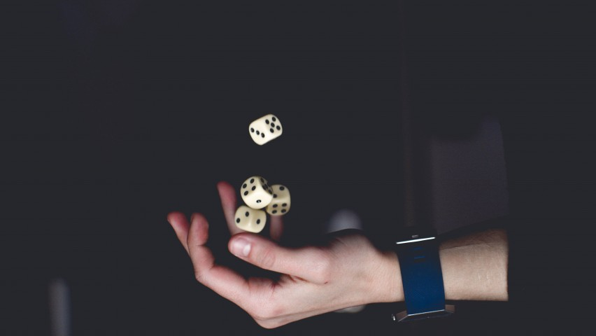 Photo of person tossing dice