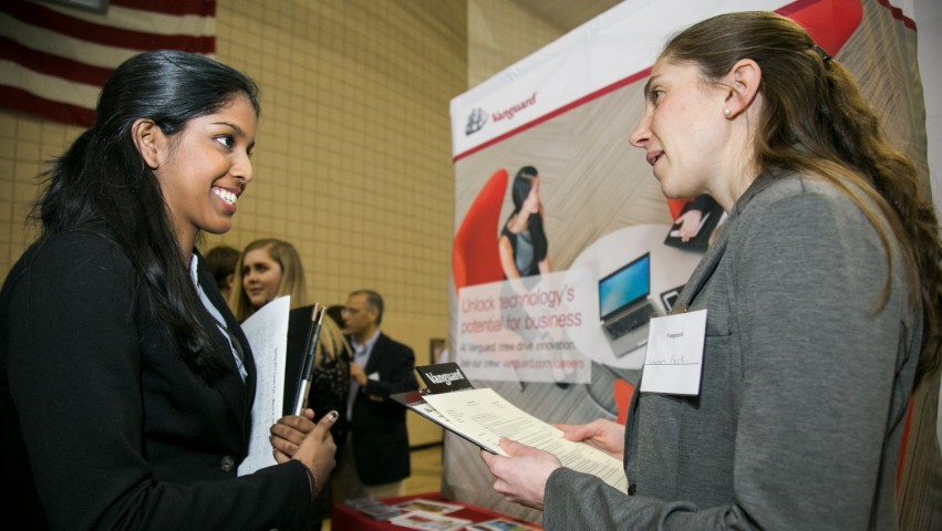 A Stevens student meets with a recruiter at a 2017 career fair