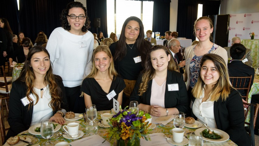 Five Stevens students gathered at a table in Bissinger Hall where luncheon was held
